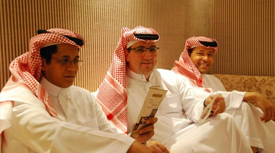 Three men in Arabic robes